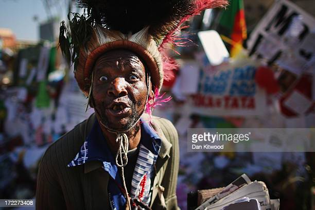 Witch doctor' says preyers outside the Mediclinic Heart Hospital where Nelson Mandela is being treated for a lung infection on July 02, 2013 in...