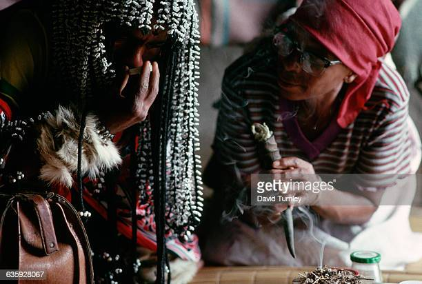 A witch doctor tries to cure a woman of her illness with potions called 'muti'