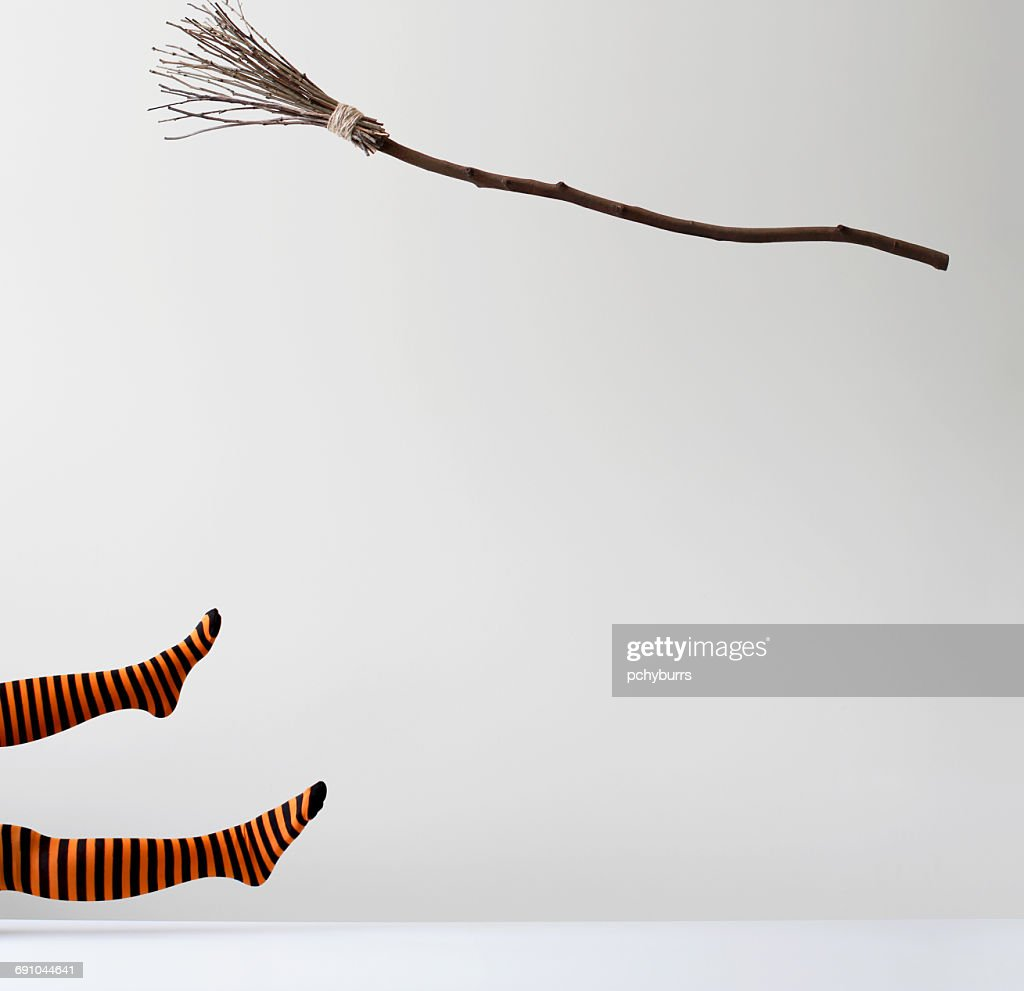 Witch falling off a broomstick : Stock Photo