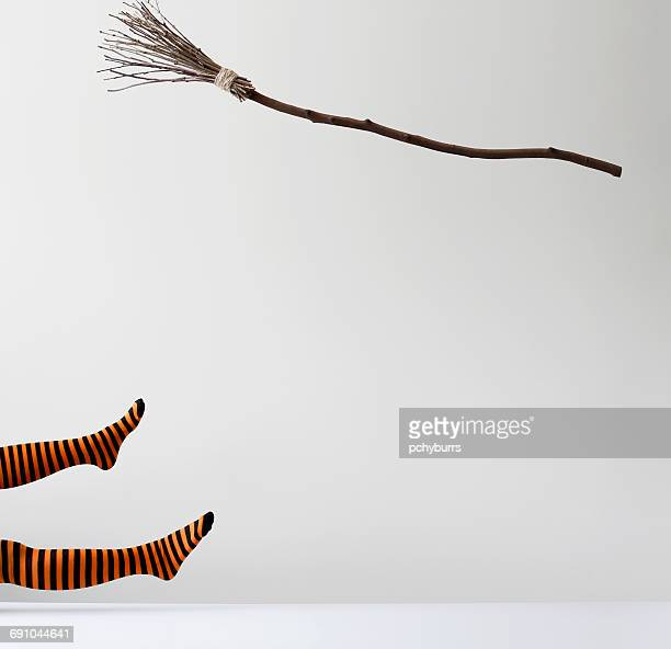 witch falling off a broomstick - broom stock pictures, royalty-free photos & images