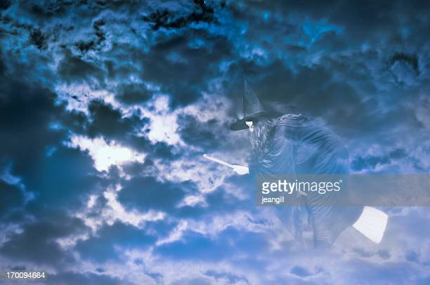 witch flying in cloudy night sky - witch flying on broom stock photos and pictures