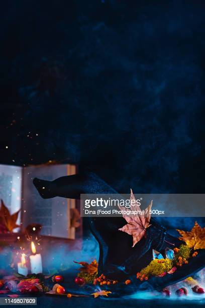 Witch Hat In A Spooky Still Life With Candles, Smoke And Sparks Occult And Magical Scene On A