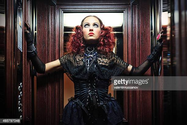 witch in elevator . halloween theme - young goth girls stock pictures, royalty-free photos & images