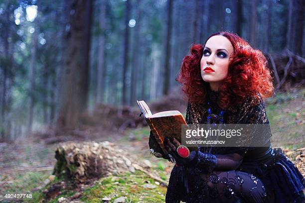 witch in the forest. halloween theme - film poster stock pictures, royalty-free photos & images