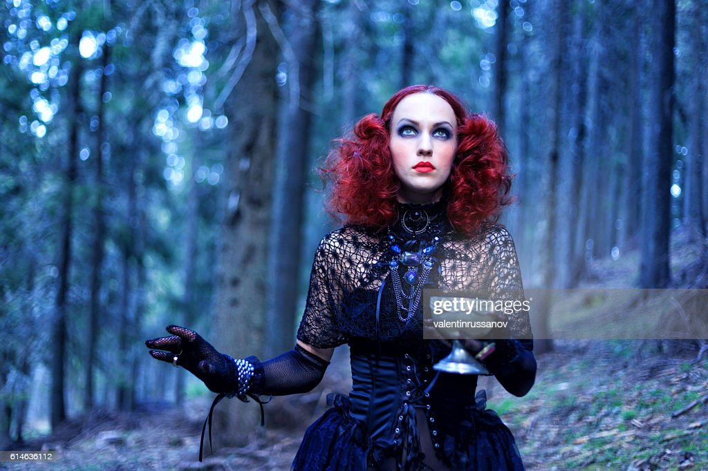 Witch in the forest. Halloween theme : Stock Photo