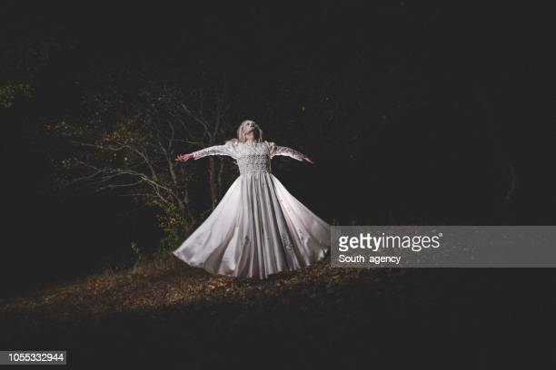 witch in white dress in dark forest - monster fictional character stock pictures, royalty-free photos & images