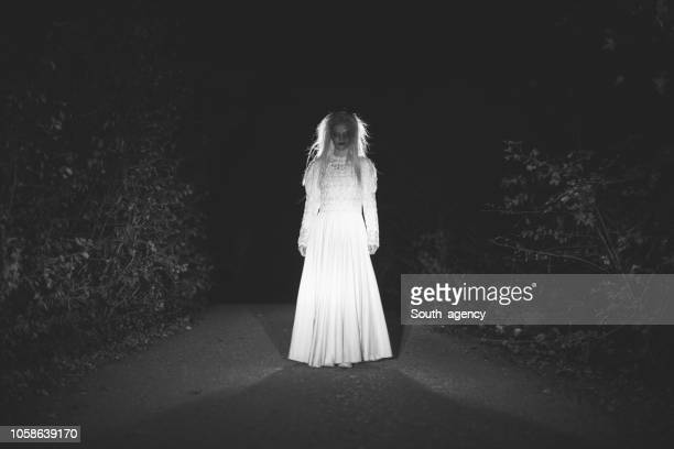 witch in white - spooky stock pictures, royalty-free photos & images
