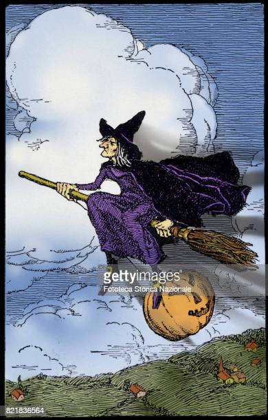 A witch on a broomstick with her a carved pumpkin traditional symbol of Halloween Colored illustration on the basis of an illustration approx 1910