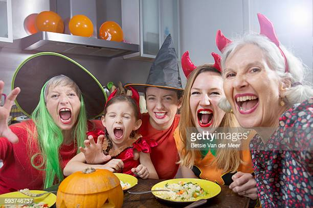 Witches and devils take Selfie at halloween dinner