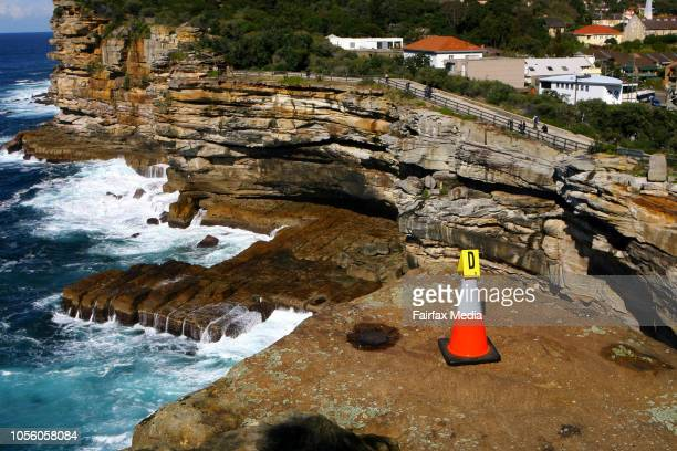 Witches hat mark the spot at a Sydney cliff where a model was allegedly thrown to her death by her boyfriend. Gordon Wood has pleaded not guilty to...
