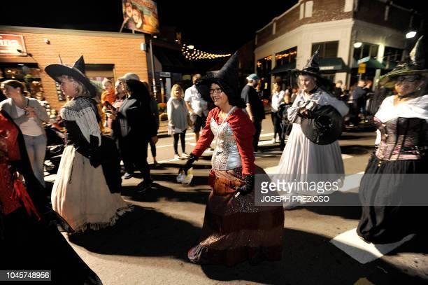 Witches make their way down the parade route during the 23rd Annual Salem Chamber of Commerce Haunted Happenings Grand Parade which launches the...