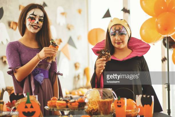 witch's cupcakes - halloween party stock photos and pictures