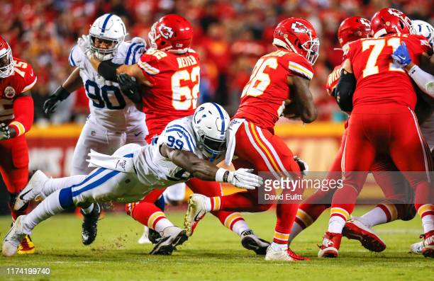 With 5:06 left in the game and fourth down and 1-yard to go, Justin Houston of the Indianapolis Colts tackles Damien Williams of the Kansas City...
