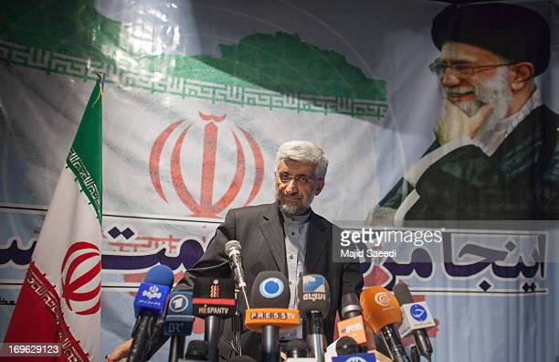 With a backdrop of a portrait of the Iranian supreme leader Ayatollah Ali Khamene Iran's top nuclear negotiator and presidential candidate for the...