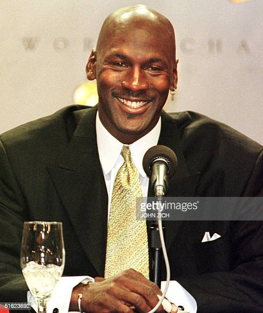 With a bandage on his finger and a smile on his face Michael Jordan of the Chicago Bulls announces his retirement from the NBA after 13 seasons...