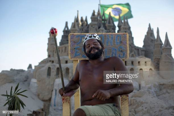 With a crown on his head Marcio Mizael Matolias sits on a throne in front of his sand castle despite the 40degree heat that punishes bathers on a...