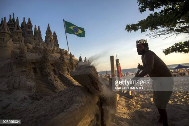 With a crown on his head Marcio Mizael Matolias works on his sand castle despite the 40degree heat that punishes bathers on a sunny summer afternoon...
