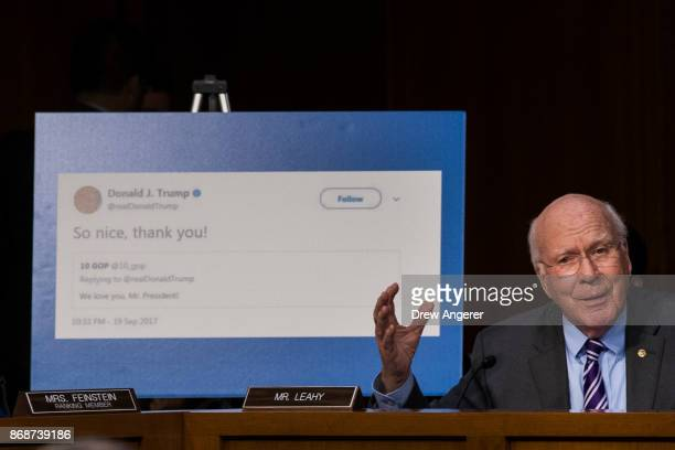 With a display showing President Donald Trump retweeting a fake Russian Twitter account Sen Patrick Leahy questions witnesses during a Senate...