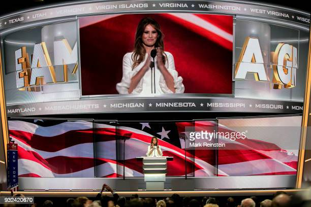 With a massive image projected above her former model Melania Trump speaks from the podium on first night of Republican National Convention at...