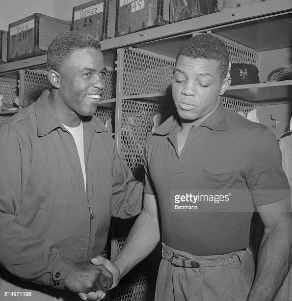 With a Oh it was nothing expression Willie Mays fleet young outfielder of the New York Giants accepts the congratulations of Brooklyn Dodger veteran...