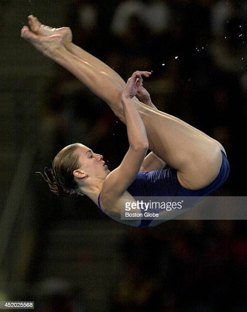 With a stream of water droplets trailing her, USA diver Laura Wilkinson tucks into a 10 meter dive. Wilkinson took a gold medal, with a score of...