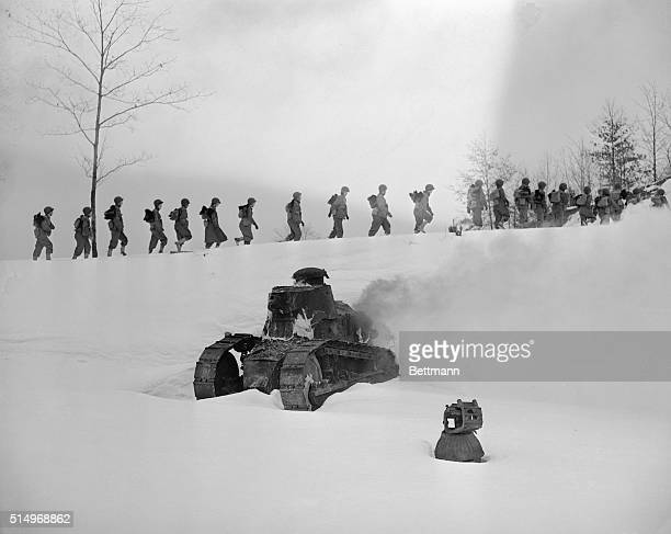 With a tank burning in the foreground to provide battle atmosphere Army Nurses taking the toughening up course at the basic training center first...