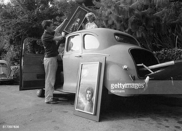 With a whole family supply of art to carry around, the Keanes' small foreign car sees plenty of use. The opening in the roof is handy for the long,...