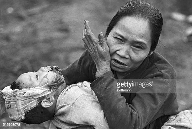 With a wounded baby in her arms an elderly Vietnamese woman makes a plea for help as she arrives at a US Marine aid station
