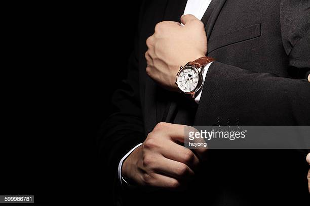 With a wrist watch