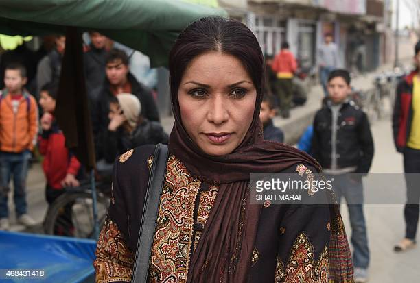 TO GO with Afghanistanunresttelevisionrightswomen by Emmanuel Parisse In this photograph taken on March 11 in a scene from a television drama Afghan...