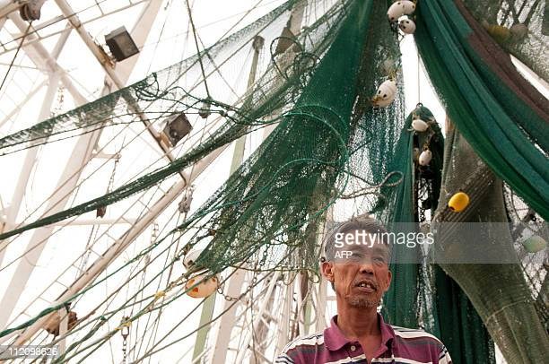 USoilpollutionenvironmentBP ==Shrimper Sanh Dixie Le waits another day without shrimping spending time on his boat 'Quoc Viet' which is docked at...