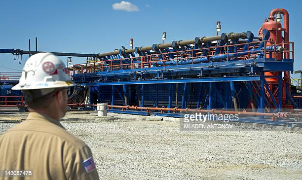 USEnergyGasEnvironment A worker walks toward a part of a Consol Energy Horizontal Gas Drilling Rig exploring the Marcellus Shale outside the town of...