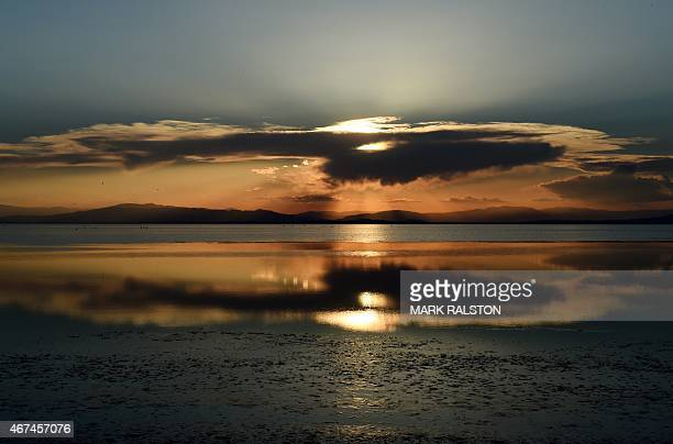 USEnvironmentWaterPollution The sun sets on the waters near Red Hill Marina at the Salton Sea California on March 19 2015 California's largest lake...