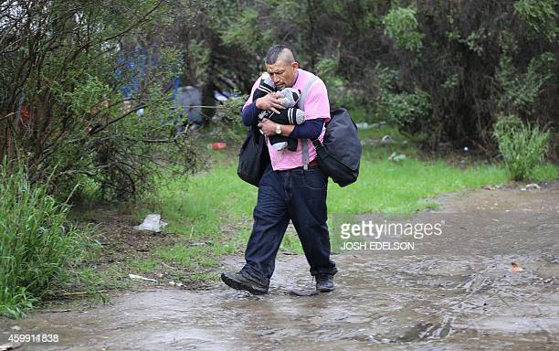 USPovertyHomelessTechnology A man who declined to give his name walks with belongings at the Silicon Valley homeless encampment known as The Jungle...