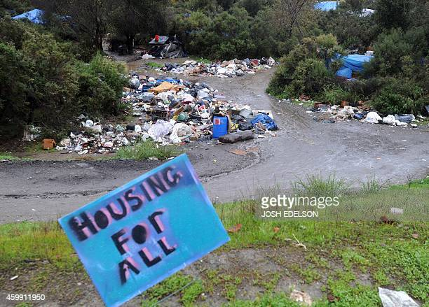 USPovertyHomelessTechnology A sign is posted near a trashlined path at the Silicon Valley homeless encampment known as 'The Jungle' on Wednesday...