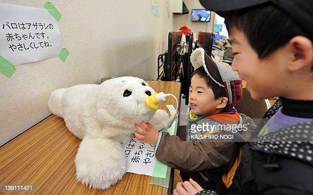 JapandisastertsunamirobotFOCUS by Shingo Ito Children displaced by the March 11 tsunami play with a therapeutic robot baby seal called 'Paro' at...