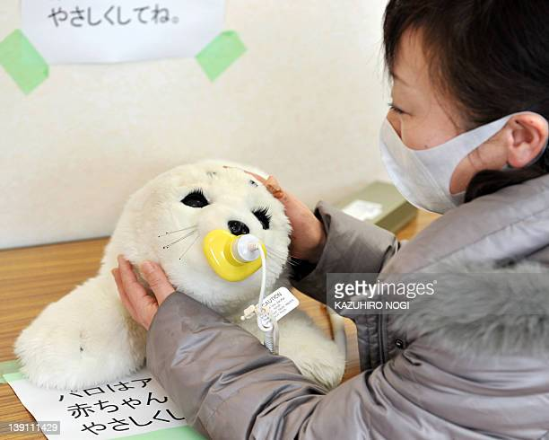 JapandisastertsunamirobotFOCUS by Shingo Ito Tsuyako Kumagai a 47yearold housewife and a survivor of March 11 tsunami disaster touches with a...