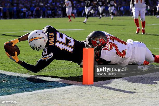 With Alterraun Verner of the Tampa Bay Buccaneers defending Dontrelle Inman of the San Diego Chargers gets the ball over the goal line to score...