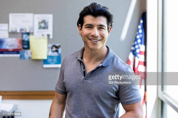 with american flag in background, military vet smiles for camera - indigenous peoples of the americas stock pictures, royalty-free photos & images