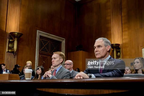 With American politician US Senator James Lankford beside him, Oklahoma Attorney General Scott Pruitt testifies before the Senate Environment and...