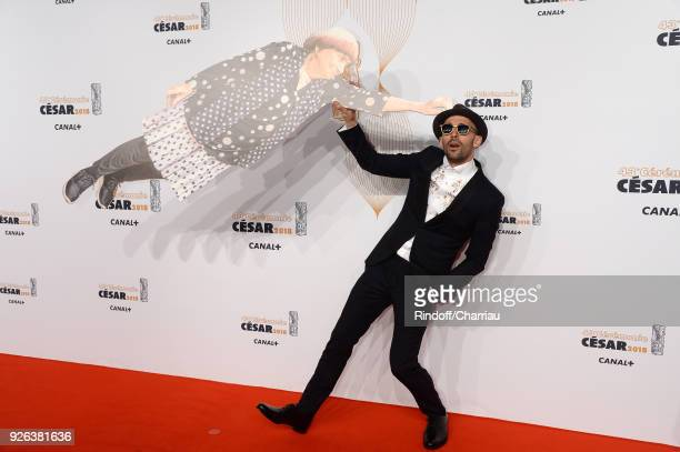 JR with an Agnes Varda's cut out arrives at the Cesar Film Awards 2018 at Salle Pleyel on March 2 2018 in Paris France
