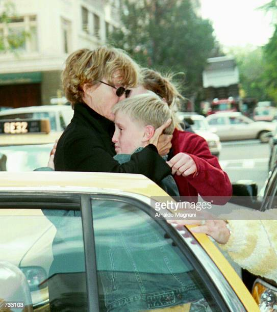 With an emotional hug Jessica Lange says goodbye to her son Samuel Walker October 23 2000 in front of a midtown hotel before she left in a taxi in...