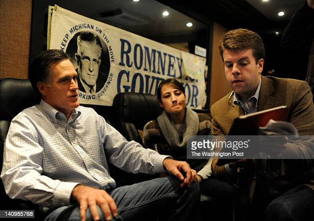 With an old gubernatorial campaign poster of George Romney behind aboard the Romney decorated campaign bus the former Massachusetts Governor Mitt...