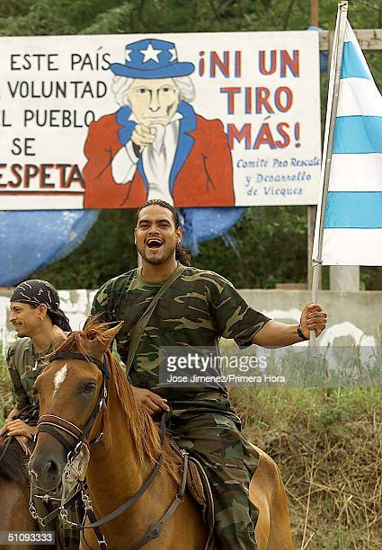 With An Uncle Sam Sign That Reads No More Bombing Behind Him Emilio Figueroa A Member Of The Riders For Peaceful Civil Disobedience Celebrates The...