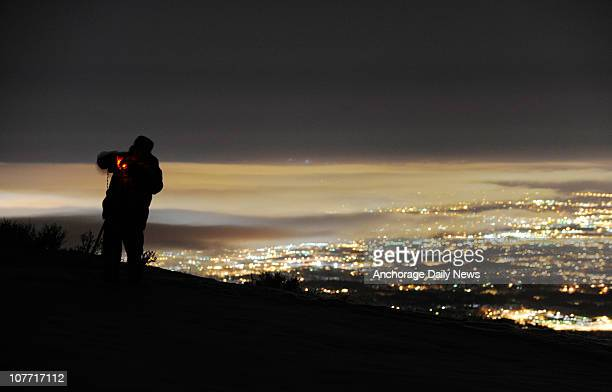 With Anchorage Alaska city lights behind him Drew Morris tries to photograph the lunar eclipse late Monday December 20 2010