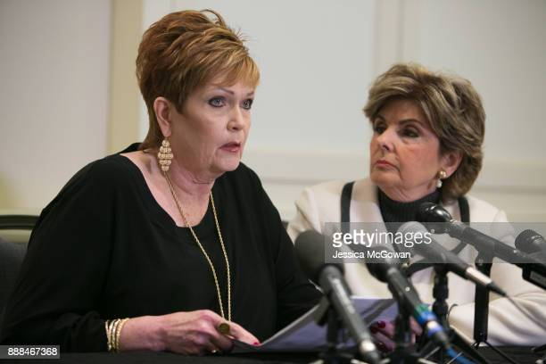 With attorney Gloria Allred Beverly Young Nelson reads a statement during a press conference to discuss an analysis of Alabama Senate candidate Roy...