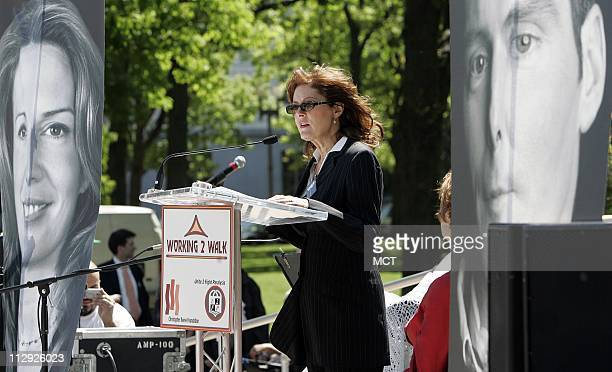 With banners of late actor Christopher Reeve at right and spouse Dana actress Susan Sarandon speaks at a rally calling on Congress to pass the...