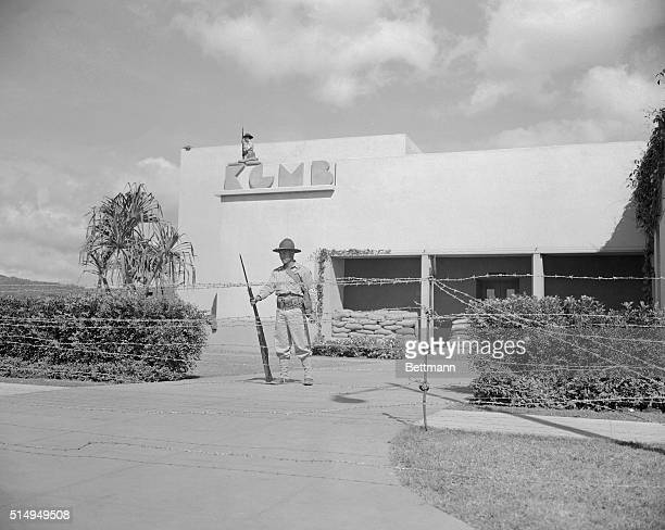 With barbed wire stretched around the grounds, members of the newly formed Hawaii territorial guard are pictured on duty at Honolulu's radio station...