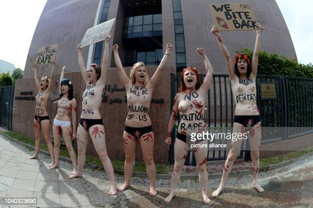 With bare breasts activists of feminist group FEMEN demonstrate in front of the Egyptian embassy in Berlin, Germany, 19 July 2013. The women want to...