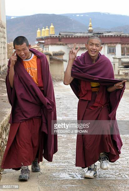 With basketball sneakers and mobile phone, young Tibetan Buddhist monks are seen walking at the Ganden Sumtseling Monastery in Shangrila on March 22,...